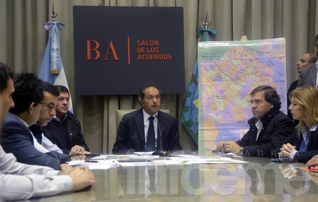 Scioli declaró la emergencia hídrica y habló de su viaje a Italia